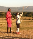 Jesse getting a lesson in Masai archery