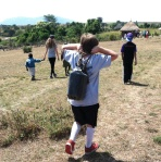 Jesse carrying water from the Mara River